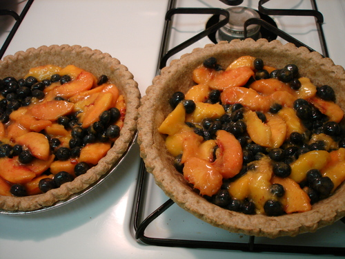 peach, nectarine, blueberry pies before crisp topping