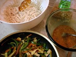 lo mein, sauted veggies, peanut sauce