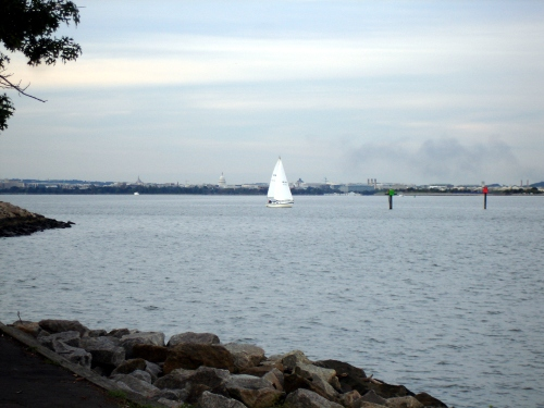 sailboat and domed building on horizon